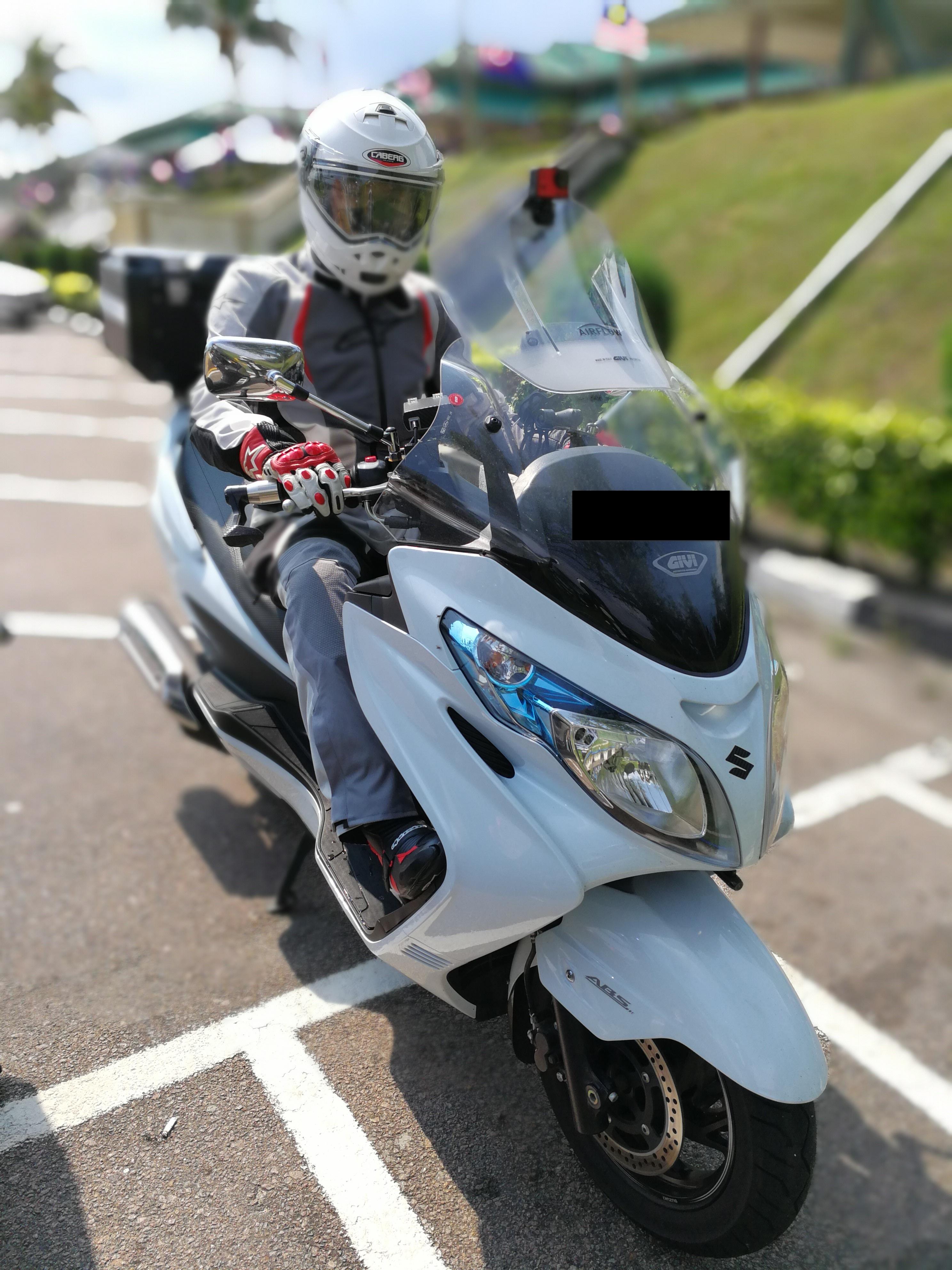 Posing on my Suzuki Burgman 400 at the pitstop on my way back from Malacca, Malaysia